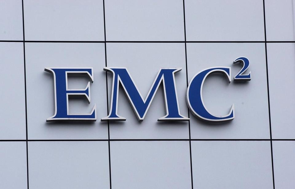 The EMC Corp. logo is seen on a building near headquarters in Hopkinton, Massachusetts, Thursday April 15, 2004. EMC Corp.'s VMware software business raised $957 million in an initial public offering today, at the top end of the forecasted range. Photographer: Neal Hamberg/Bloomberg News Library Tag 08282010 Metro --- bdc-globe100-wherearetheynow